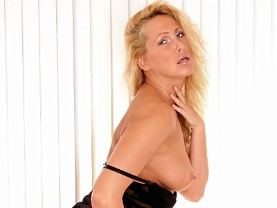 This blonde porn star stepped in and began acting sexy in front of the camera. Soon she attracts two horny black guys and began seducing them by showing off her ample set of knockers and went down on them and gave them turns cramming her with their rods.